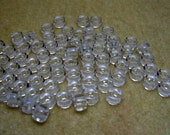 9mm x 6mm Strand Jablonex Pressed Glass Roller Crow Pony Beads in Crystal (61)