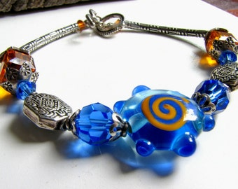 Copper Blues Bracelet, Lampworked Blue and Copper Flower, Sterling Silver, Swarovski Crystal, Sterling Jewelry