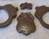 Chocolate handcuffs, chain, and police badge party favor