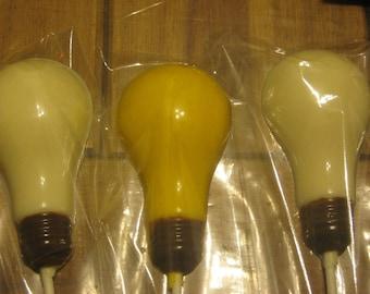 One dozen realistic light bulb lollipops