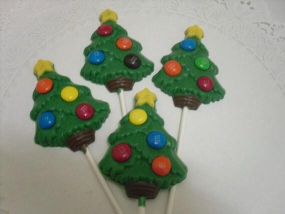 A dozen large Christmas tree lollipops