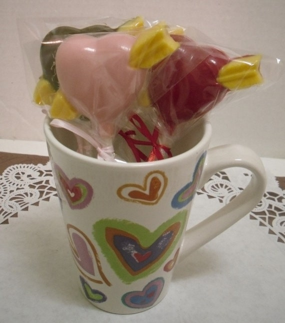 A dozen heart and arrow lollipops