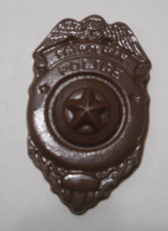 A dozen Patrolman Police Badges