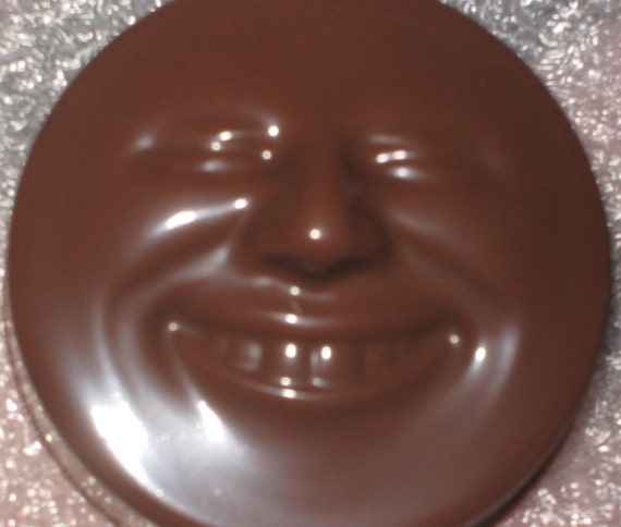 Smiling happy face chocolate covered sandwich cookie oreos party favors