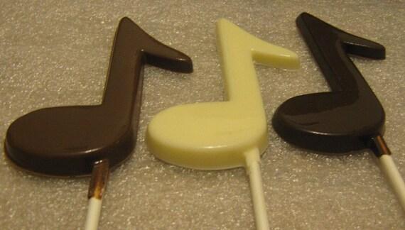 One dozen music note lollipop suckers