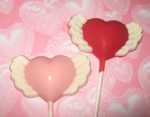 One dozen heart with wing lollipop sucker party favors
