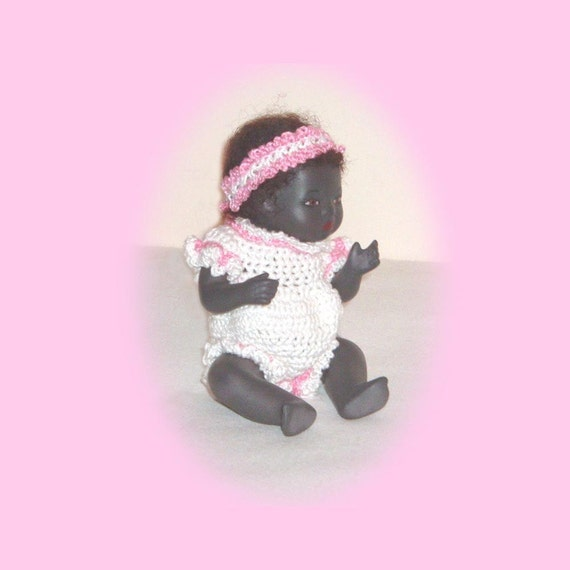 20- 5 inch By-Lo Baby Doll with crocheted romper and headband trimmed in pink