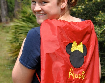 Mickey Mouse design along with an embroidered name of your choosing Cinch bag