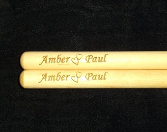 Think Valentine's Day - Personalized laser engraved drumsticks with 2 names and 2 hearts between