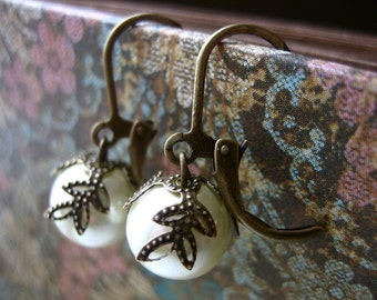 pretty pearl earrings - leaf bead capped glass pearls on antique bronze.