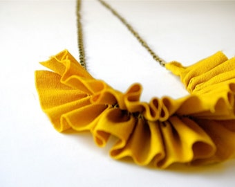 linen ruffle necklace in mustard yellow. antique bronze chain.