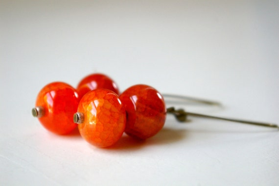 adena earrings. natural fire agate beads on antique bronze. last pair.