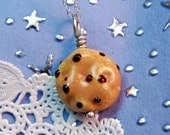 a Chocolate Chip Lampwork Cookie Pendant before bedtime - aStudiobytheSea