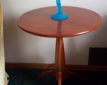 Cherry wood candle stick table