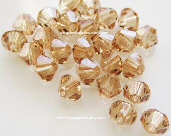 Bead, Swarovski Crystal Light Colorado Topaz, 4mm Xilion Bicone