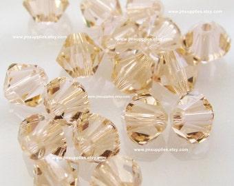Bead, Swarovski Crystal Light Peach 4mm Xilion Bicone