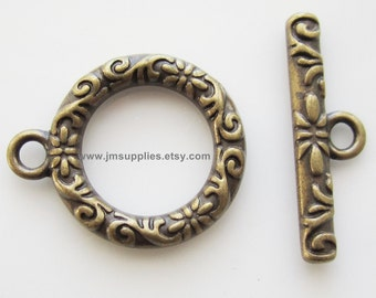 Toggle Clasp, Antiqued Gold 17mm Single Sided Round With Vine And Flower Design