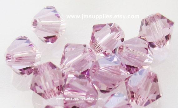 Bead, Swarovski Crystal Light Amethyst, 4mm Xilion Bicone