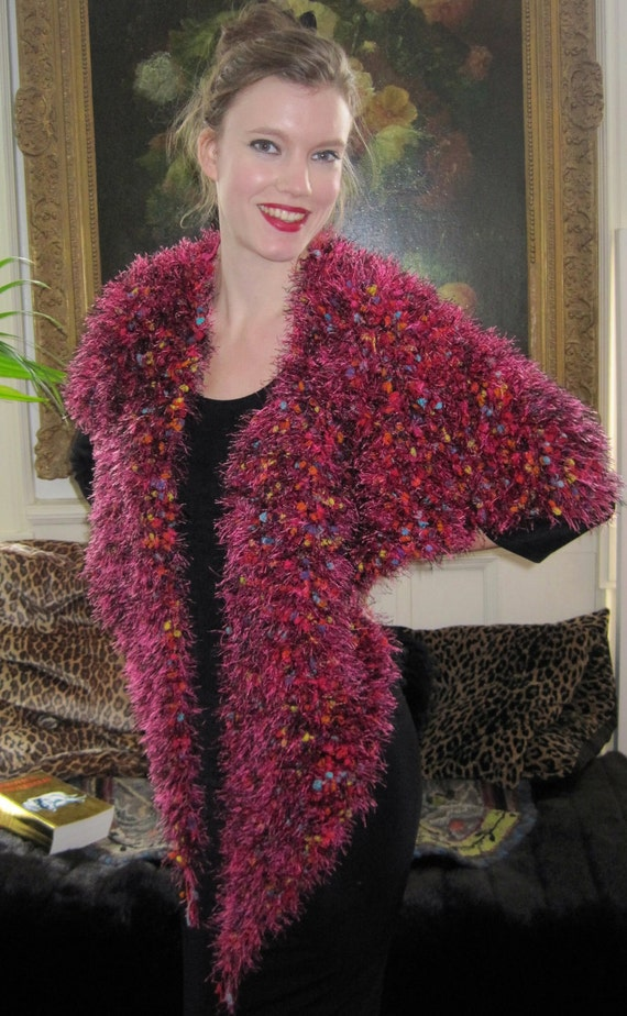 BASIA DESIGNS Shawl/Scarf hand knit in predominantly red, pink and black yarn with multicolored specks.