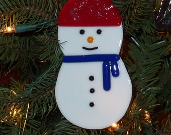 Snowman With Red Hat and Blue Scarf