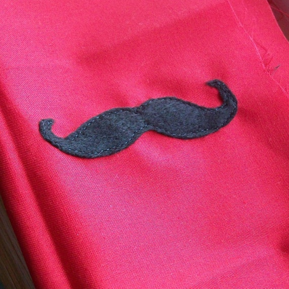 Add a felt mustache to any tie onesie