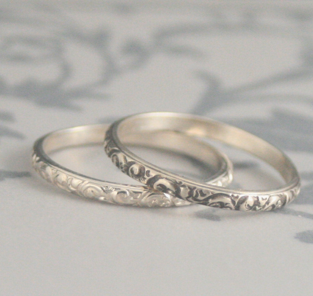 rococo in the discothin sterling silver swirl patterned
