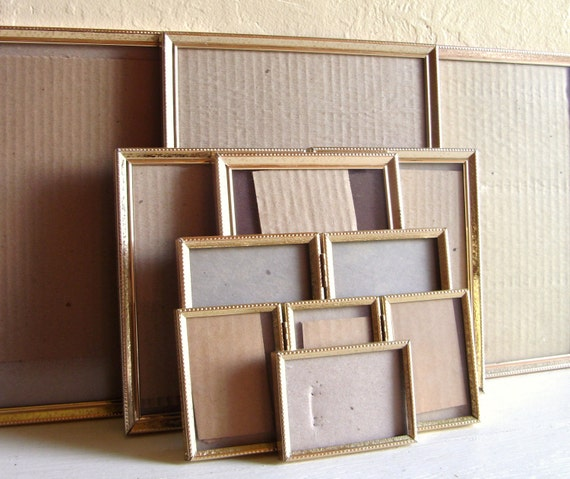 Large Collection of Matching Gold Metal Picture Frames