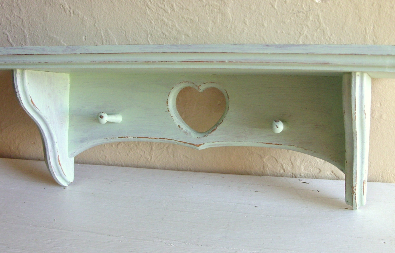 Distressed Light Green Wood Wall Shelf With Hooks By