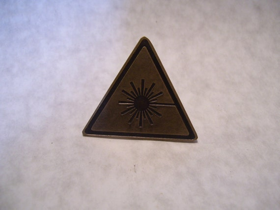 Laser Warning Sign    Etched brass pin
