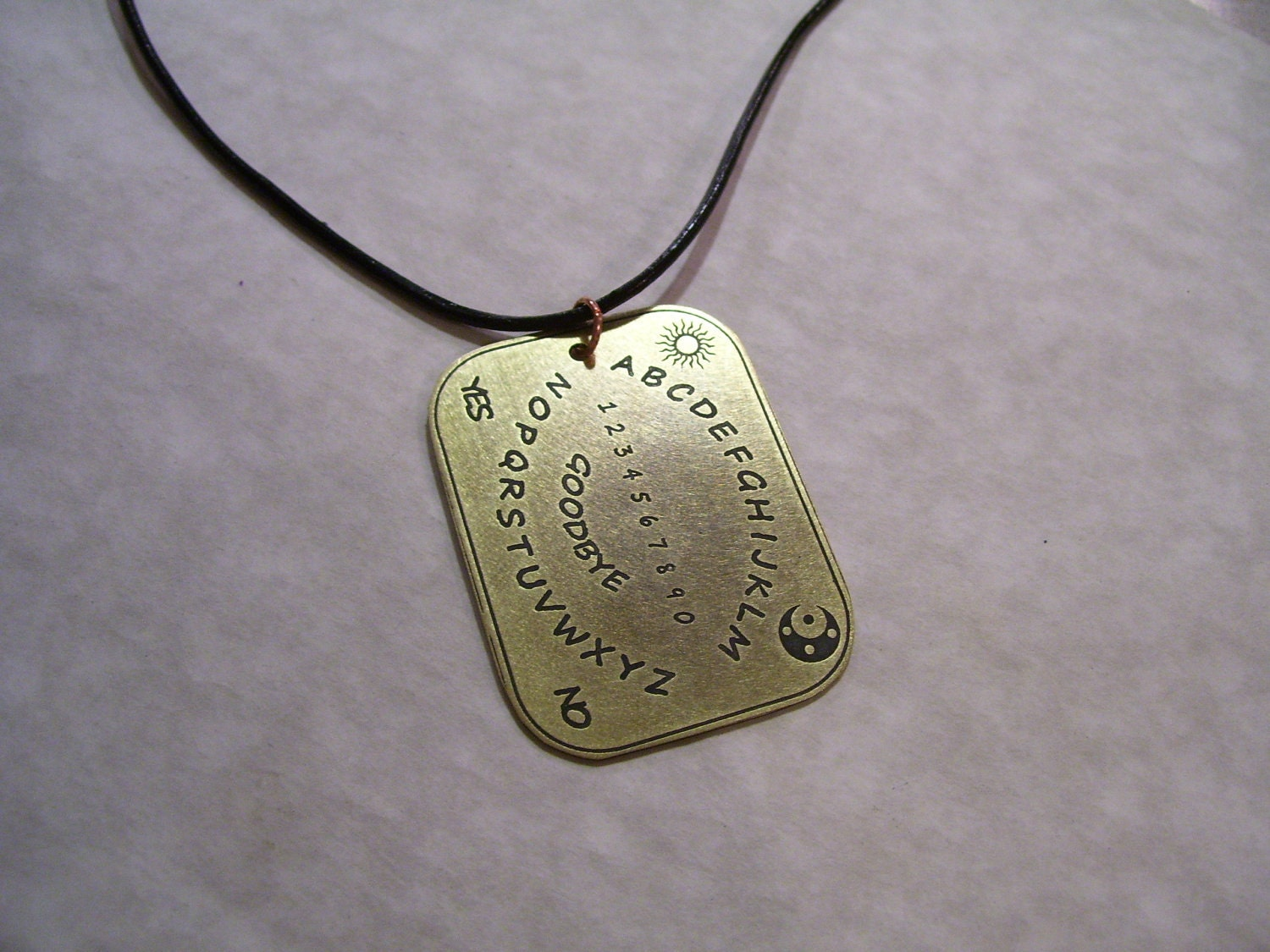 etched brass ouija board pendant