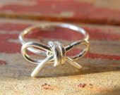 sterling silver bow wire ring in your size. DON'T FORGET. free shipping domestic