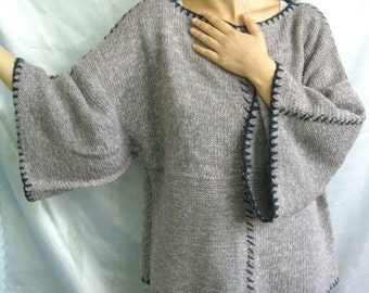 Hand knitting poncho for winter
