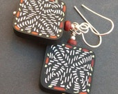 artisan polymer clay earrings black and white weave pattern beads-  knot