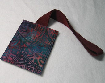 Dark purple tribal-style luggage tag