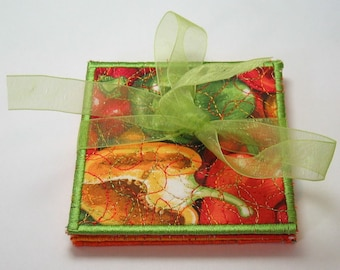 Pepper coasters -- multi-colored trim -- tan/orange backing (set of 4)