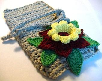Crochet gray handbag with multicolor flower