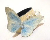 Elegant leather bracelet with butterfly. Pastel colors
