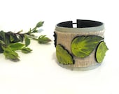Leather bracelet with green leather leaves