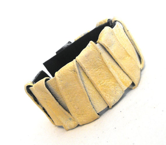Leather bracelet with gold color strips. Leather jewelry