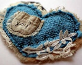 mini art quilt heart in aqua with embroidered pocket for joy