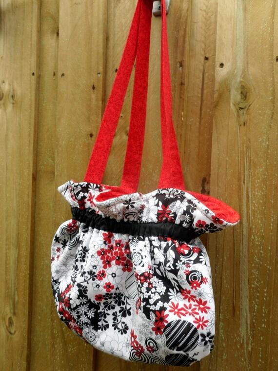 Black, red and white shoulder bag