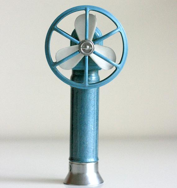 vintage blue metal hand held fan
