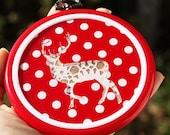 Acrylic doily deer hoop wall art hanging on red polka dots