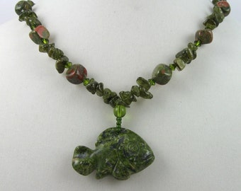 Green fish necklace, garnet chips and carved unakite pendant, boho beach jewelry