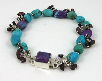 Purple Turquoise Bracelet with garnet chips, blue turquoise nuggets, and sterling silver box clasp with gemstone inlay