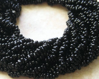 4x2mm Opaque Jet Black Czech Glass Farfalle Seed Bead Strand (AW100)