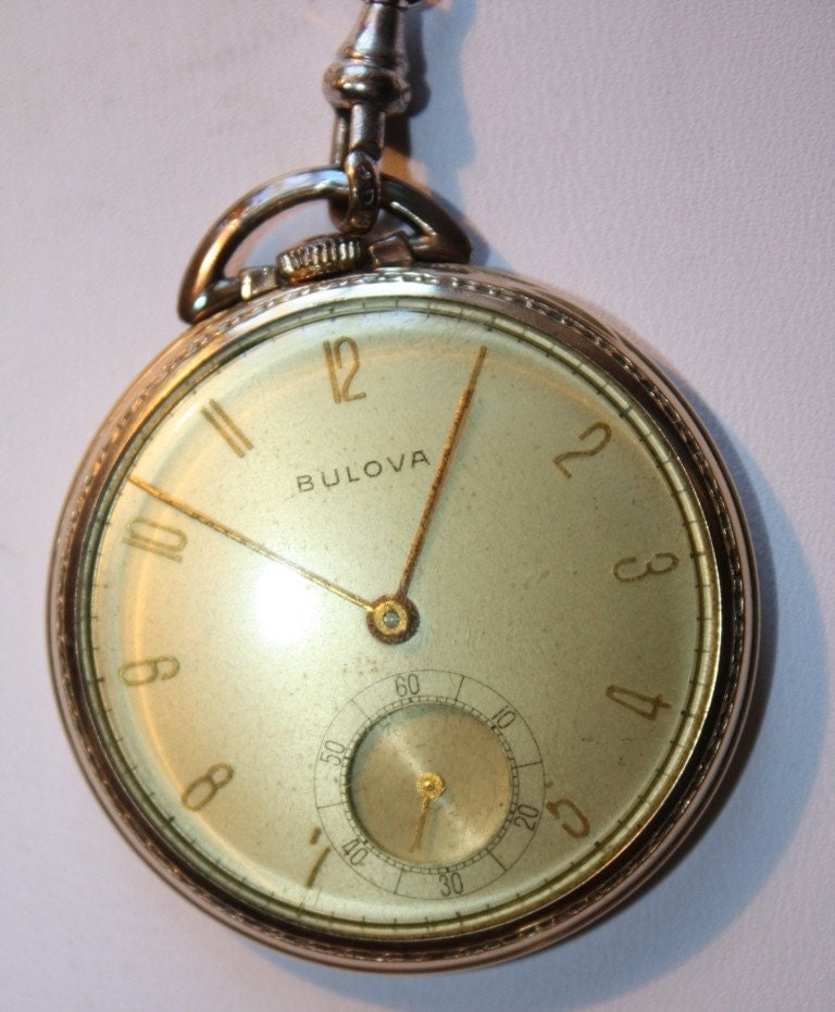 vintage bulova pocket complete with fob and in original