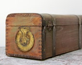 vintage wooden treasure chest with gold accents and dovetail corners