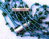 Beautiful blue and green draped necklace 4 tier with silver accent