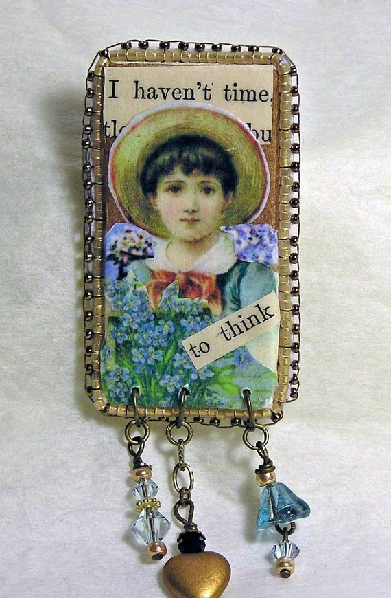 vintage text and image brooch